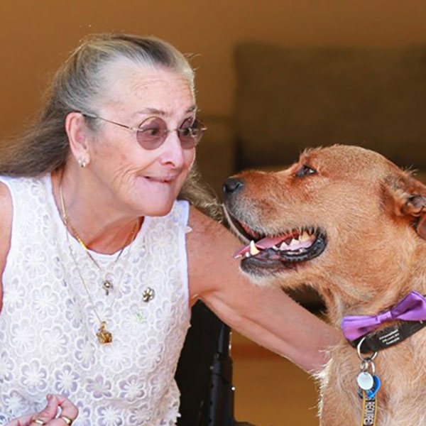 Photo of Judith Geppert together with her dog