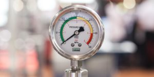 A pressure gauge. Doing things that don't scale may keep the pressure low but it also may stop your startup growing. Photo by Crystal Kwok on Unsplash.