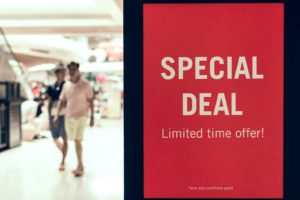 A red sign in a shopping centre that says 'Special Deal Limited time offer only.'