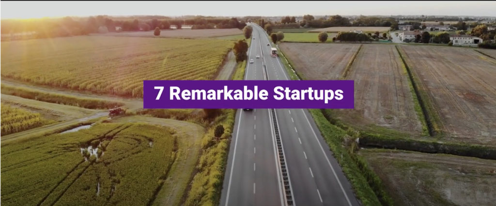 Country Road landscape at sunset with a highway in the centre of the image and a purple bold title '7 Remarkable Startups'